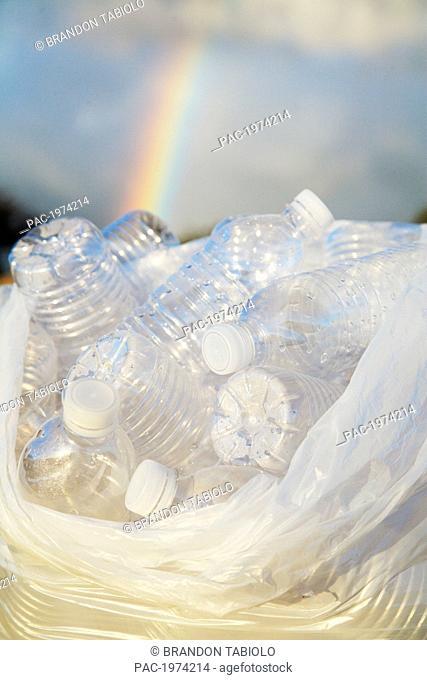 Hawaii, Oahu, Bottles Of Water In A Trash Bag On The Beach