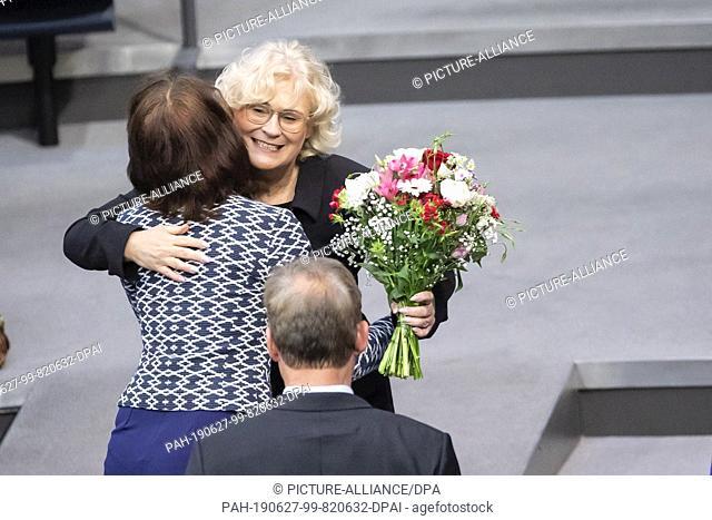 27 June 2019, Berlin: Katarina Barley (SPD), member of the German Bundestag and former Federal Minister of Justice, congratulates her successor Christine...
