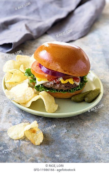 A burger with potato crisps