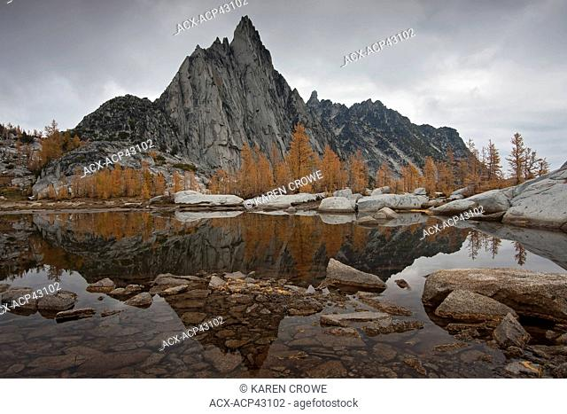 Prusik Peak and Larches Reflected in Gnome Tarn, Upper Enchantments, Alpine Lakes Wilderness, Washington State, USA
