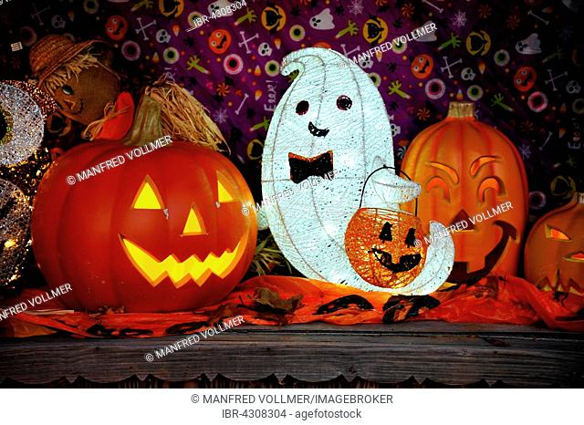 Halloween decoration with glowing pumpkins in front of a house, New York, USA