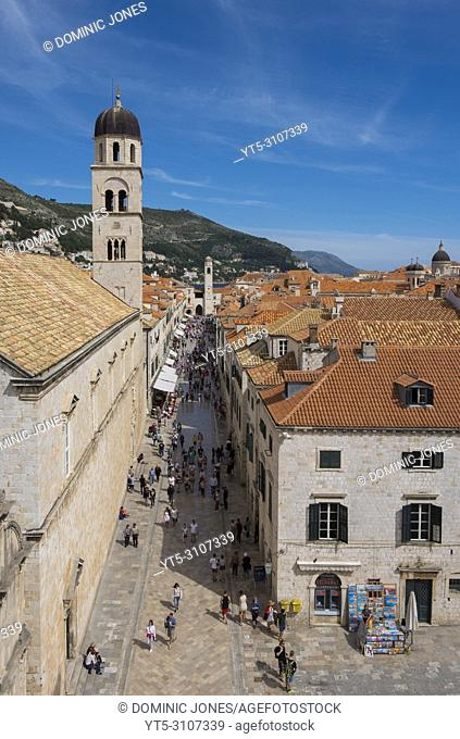 The Franciscan Church Tower on the left overlooking the Stradun in the Old Town of Dubrovnik, Croatia, Europe. . Dubrovnik, Croatia, Europe