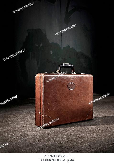 Leather suitcase abandoned on street