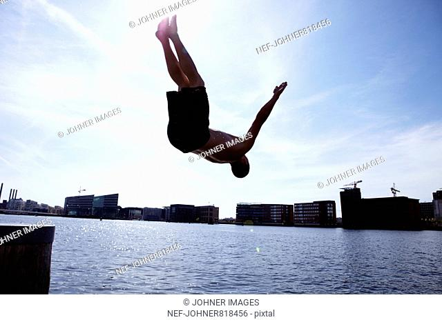 Man jumping into the water, Denmark