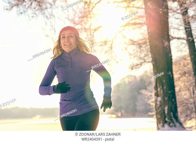 Pretty Woman Jogging in winter with earphones