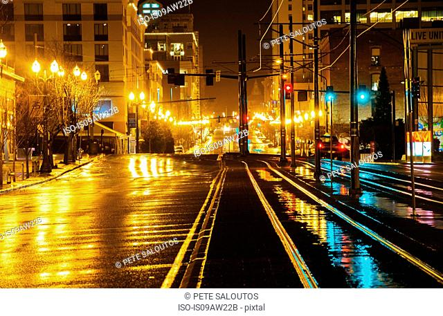 Cityscape with street and tram line at night, Tacoma, Washington, USA