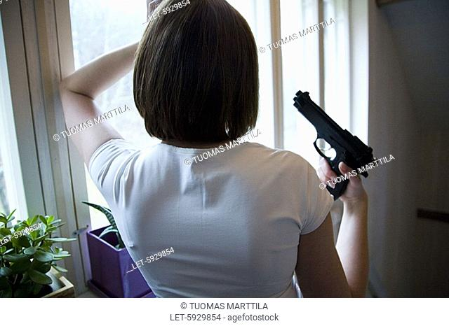 Woman with gun  Aggression
