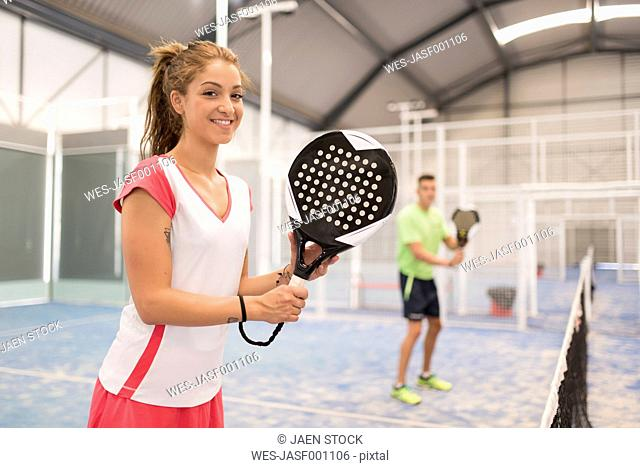 Smiling female paddle tennis players on court