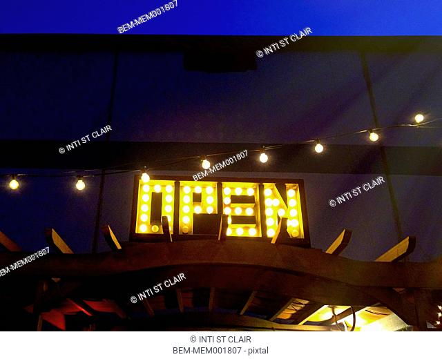 Low angle view of open sign on building
