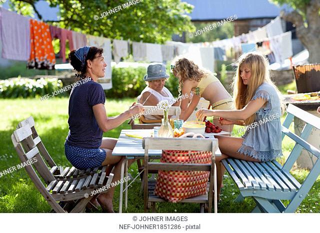 Family having meal in garden