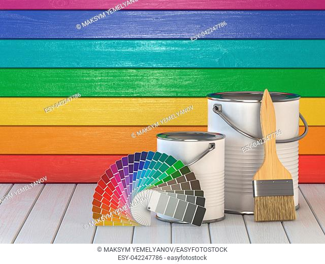 House renovation and improvement concept background. Paint cans, paint brush and color palette on wooden wall painted in a colors of the rainbow