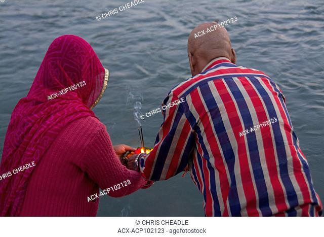 praying to Mother Ganges prior to the Arti at Ganga Aarti at Triveni Ghat, Rishikesh, Uttarakhand, India