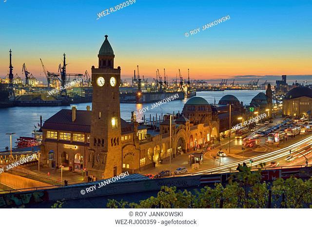 Germany, Hamburg, Port of Hamburg and Landungsbruecken at sunset