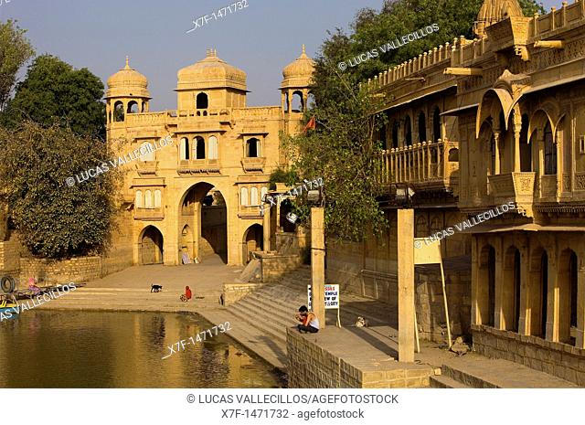 Tilon ki Pol archway in Gadi Sagar, the tank was once the water supply of the city and is surrounded by small temples and shrines, Jaisalmer,Rajasthan, India
