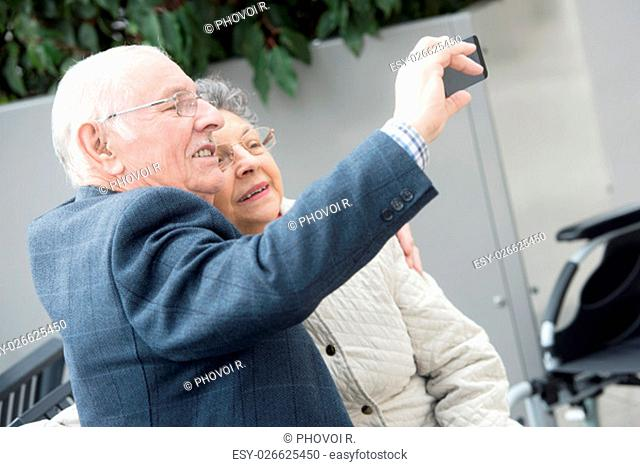 elderly couple taking selfie