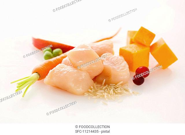 Raw Cubes of Chicken with Assorted Ingredients