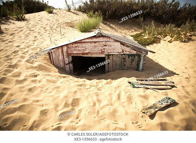 Small house buried by the dunes, Porto Santo beach, Madeira
