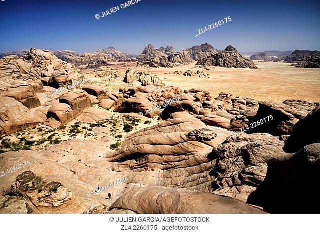 2 persons walking on the mount Jebel Burdah. Jordan, Wadi Rum desert, protected area inscribed on UNESCO World Heritage list