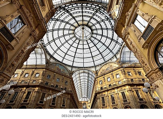 Ornate interior architecture with a glass domed ceiling; Milan, Italy