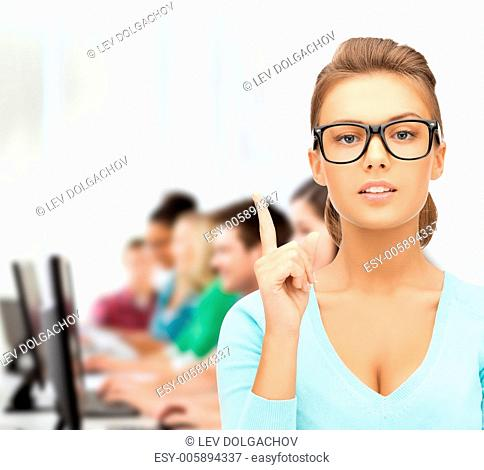 education, vision, optics concept - attractive student or teacher wearing glasses in college