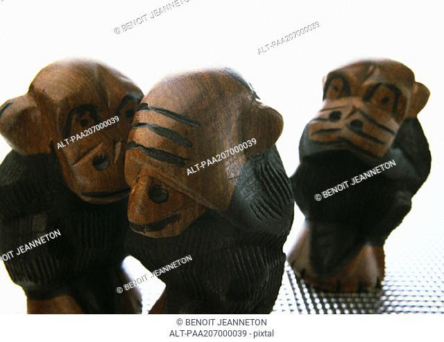 Three wise monkeys, sculpture, close-up