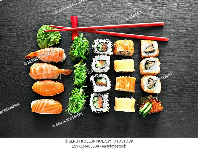 Sushi set and chopsticks on a slate table