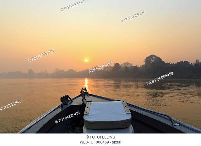 Brazil, Mato Grosso do Sul, Pantanal, Boat on Cuiaba River at sunrise