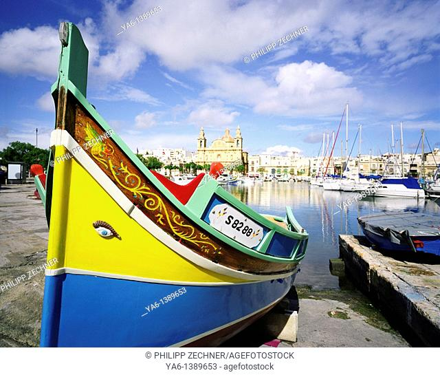 Traditional fisherman boat in the harbour of Msdia, Malta
