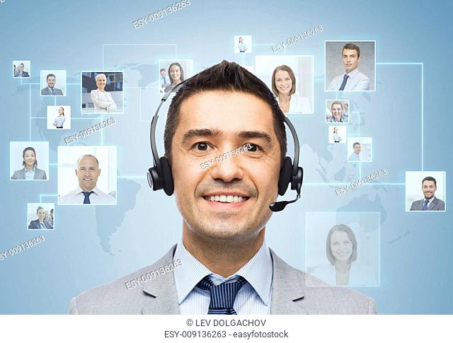business, people, technology and service concept - smiling businessman in headset over virtual contacts icons projection and blue background