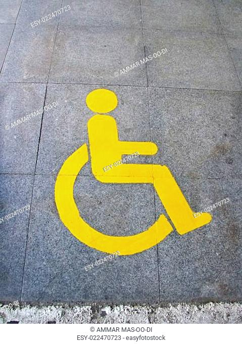 Yellow handicapped sign of floor tile