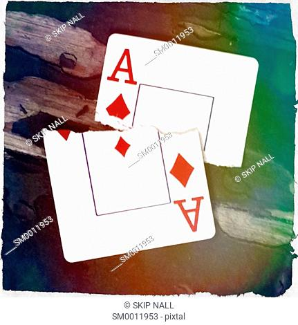 The ace of diamonds from and deck of playing cards torn in half