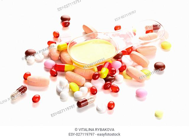 Close up shot of different pills isolated on white background