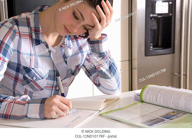 Girl 14, studying at home