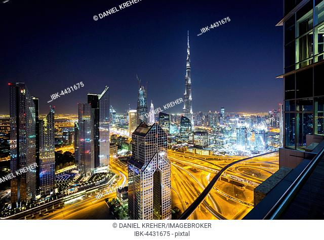 View of skyline from Shangri La Hotel at night, illuminated Sheikh Zayed Road, Burj Khalifa, Downtown, Dubai, United Arab Emirates
