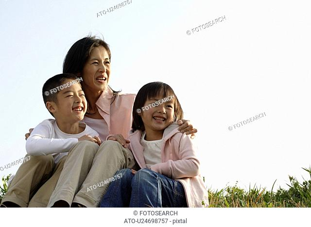 View of a mother smiling with children