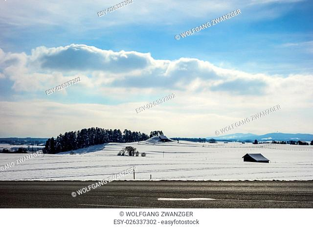 Image of a road in winter landscape in Bavaria, Germany on a sunny day