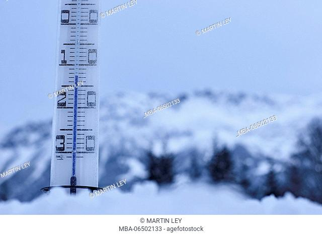 large thermometer puts in the snow, frost, cold, mountains, winters