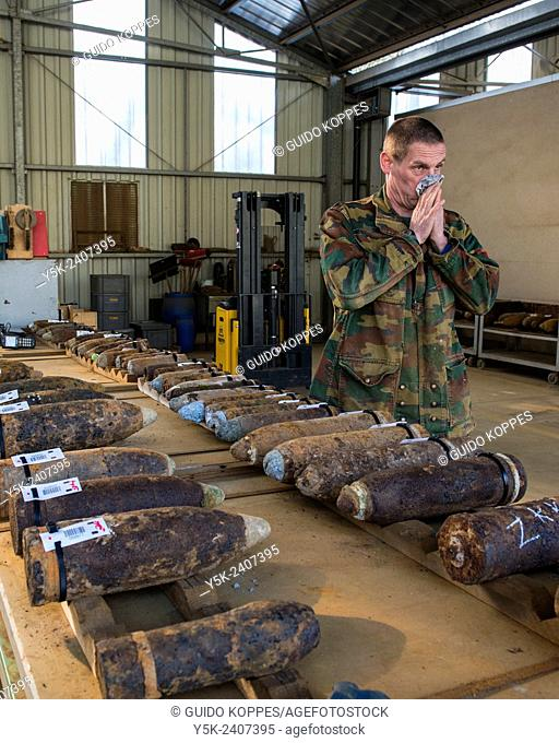 Poelkapelle, Belgium. Army Battalion for Demolition of Explosives. Army chief corporal working on the identification and classification of recovered live World...