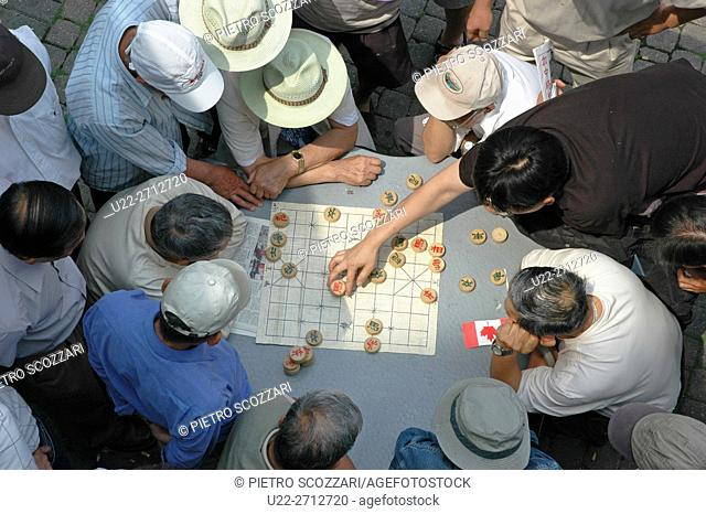 Toronto, Canada: Chinese men playing Chinese chess at Chinatown