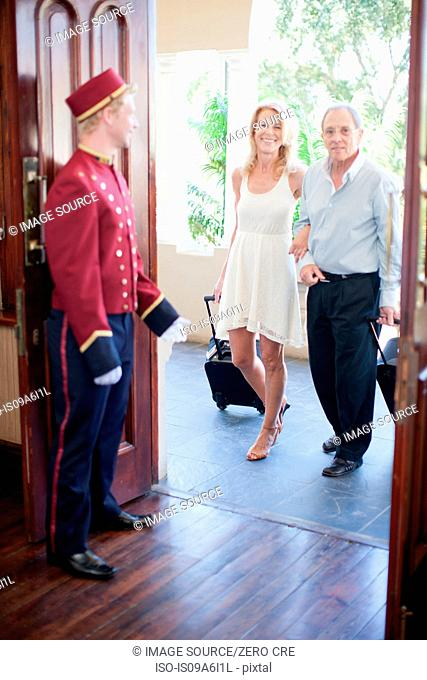 Older couple walking into hotel