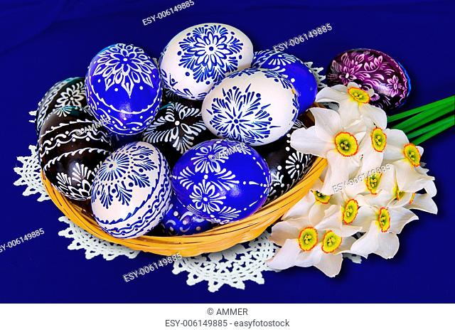 Ornamental Easter eggs and bouquet of daffodils