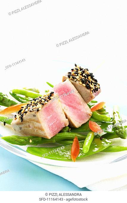 Tuna skewer on a bed of steamed vegetables