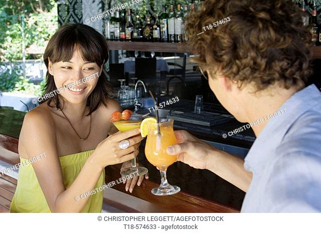 couple toasting at bar