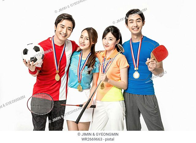 Young smiling Korean sports players winning medals