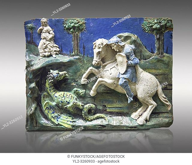 Enamelled terracotta relief panel of Saint George sleighing the Dragon. Made in Florence around 11520. Inv RF 3096, The Louvre Museum, Paris