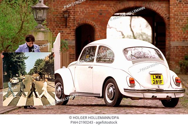 Sonja Ticehurst presents a VW Kafer from the possession of the late Beatle singer John Lennon and a picture of the vehicle together with the British pop group...