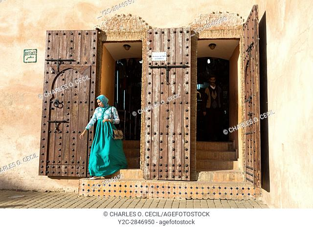 Meknes, Morocco. Woman Exiting a Shopping Area