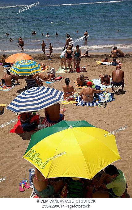 People sunbathing and swimming on the beach of Playa de las Canteras, Gran Canaria, Canary Islands, Spain, Europe