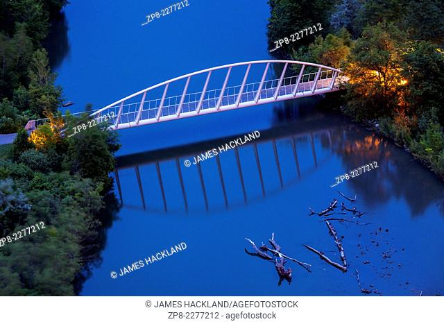 A pedestrian bridge crossing the Humber River in Humber Bay Park at dusk. Toronto, Ontario, Canada