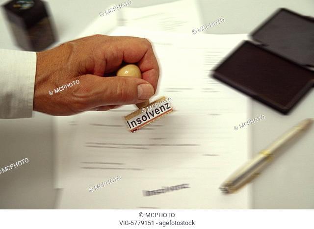 Hand mit Stempel mit der Aufschrift Insolvenz, 2005 - Germany, 20/05/2005